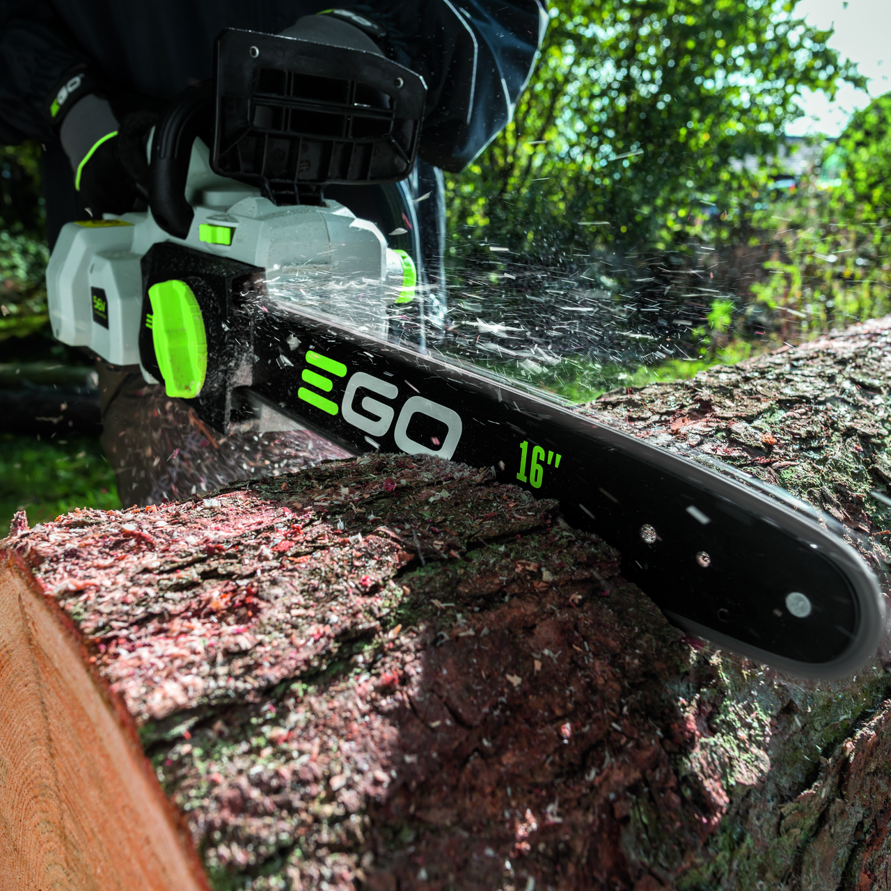 EGO Chainsaw saws through log
